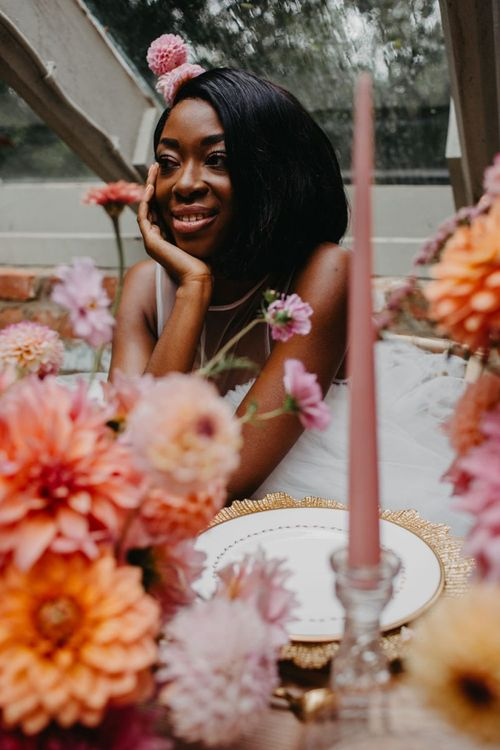 Beautiful bride sitting at an intimate tablescape
