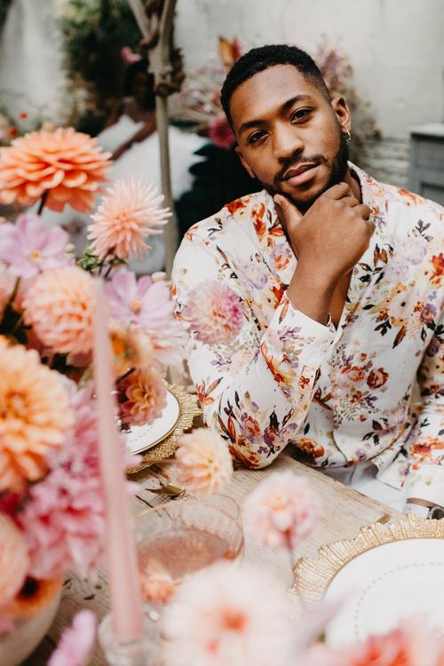 Groom in floral shirt at intimate wedding