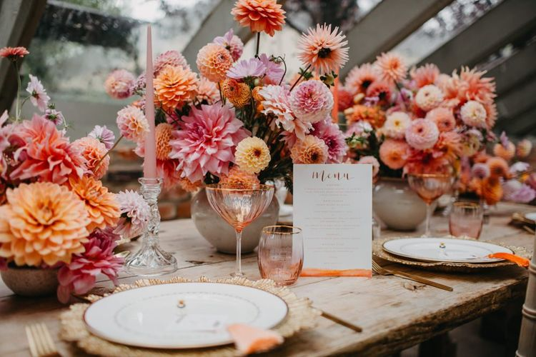 Colourful wedding flower centrepieces and details for intimate wedding at Secret Garden Kent