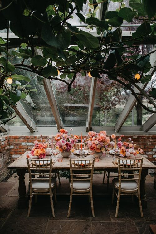 Intimate wedding reception table with floral centrepieces at Secret Garden Kent