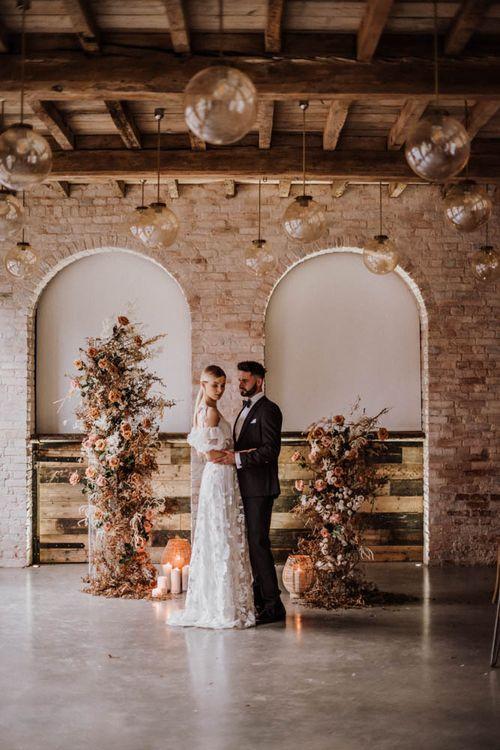 Bride in Emma Beaumont wedding dress inside Iscoyd Park Coachhouse