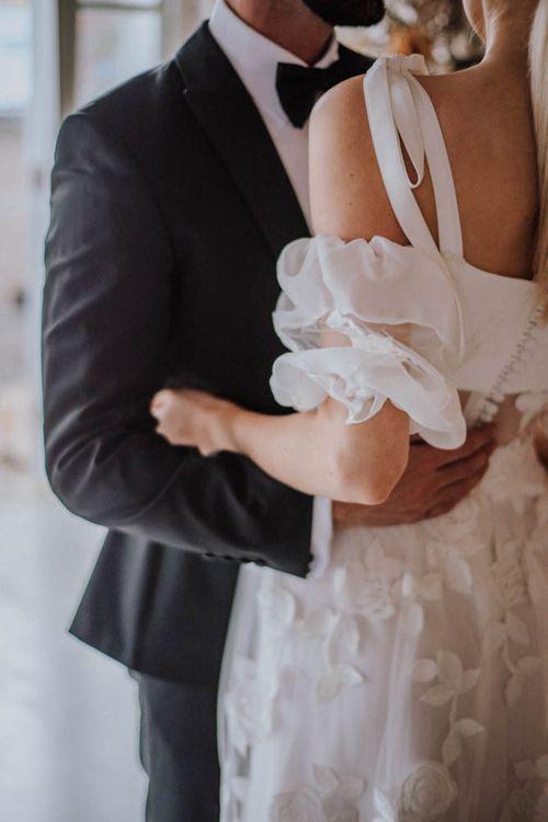 Puff sleeves on stylish Emma Beaumont wedding dress