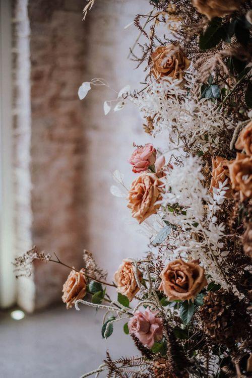 Orange and white wedding floral arrangement