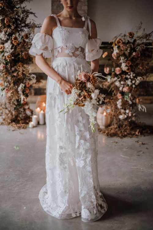 Emma Beaumont wedding dress with appliqué detail and bow straps at Iscoyd Park Coach House