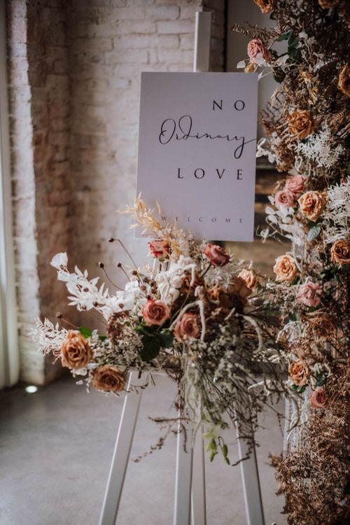 No ordinary love wedding sign in Iscoyd Park Coachhouse