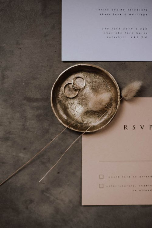 Gold ticket bowl and pink RSVP card