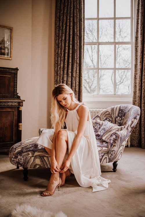 Bride getting ready at Iscoyd Park in Emma Beaumont wedding dress