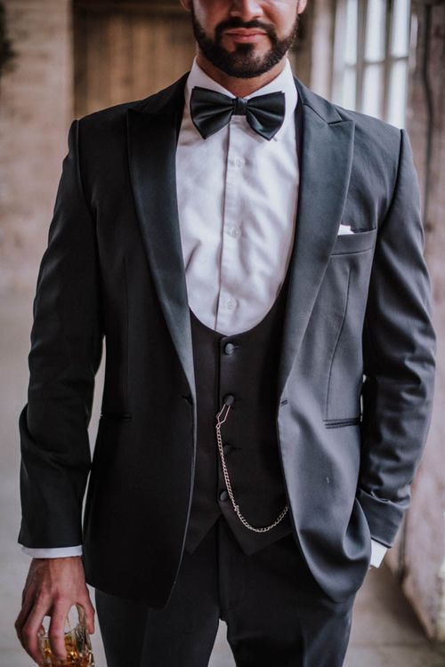 Groom in lounge suit with horse shoe waistcoat at Iscoyd Park