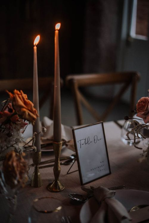 Coloured taper candles in gold candlesticks at Iscoyd Park Coach House