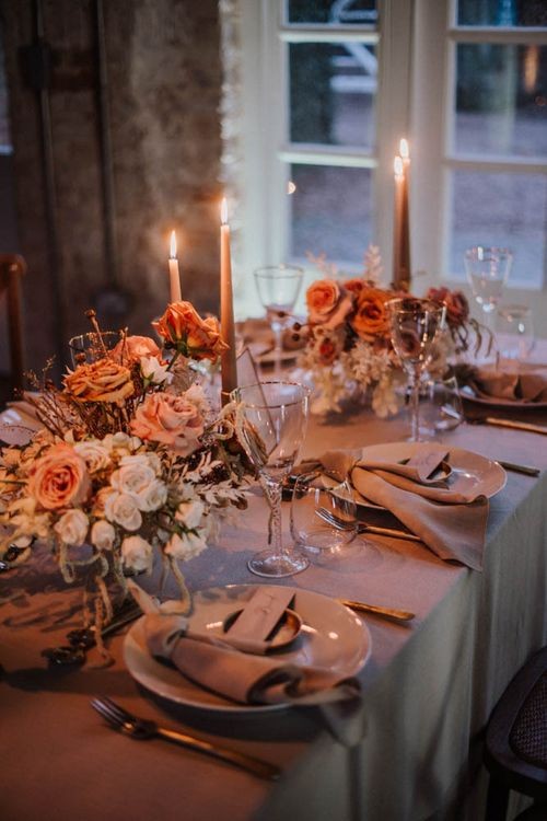 Candle lit wedding table at Iscoyd Park Coachhouse styled By Chenai