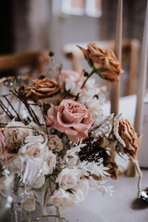 white, pink and orange wedding flower centrepiece