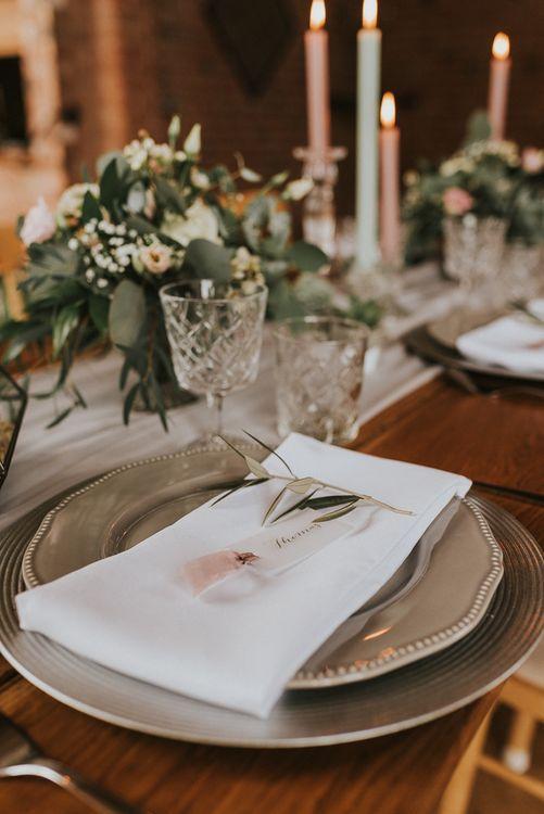 Elegant Place Setting with Grey Crockery, White Napkin and Olive Stem