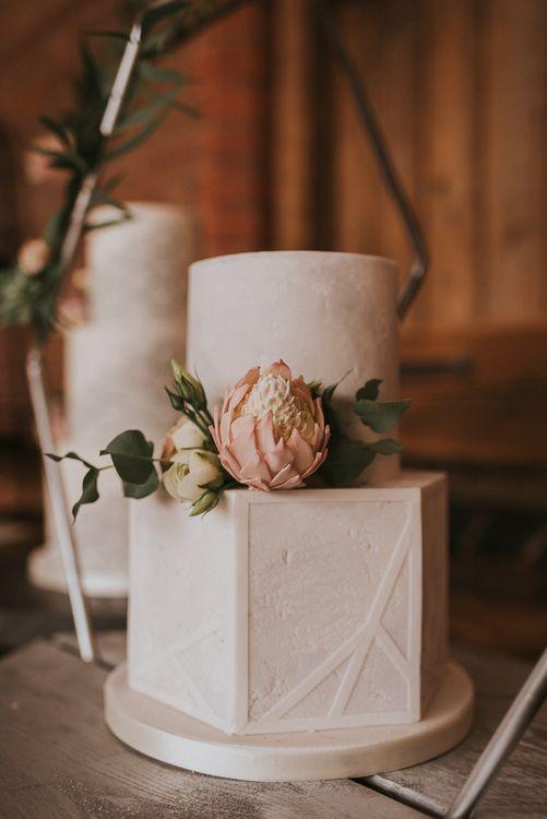 Hexagonal Tiered Wedding Cake with Blush Pink Flower Detail