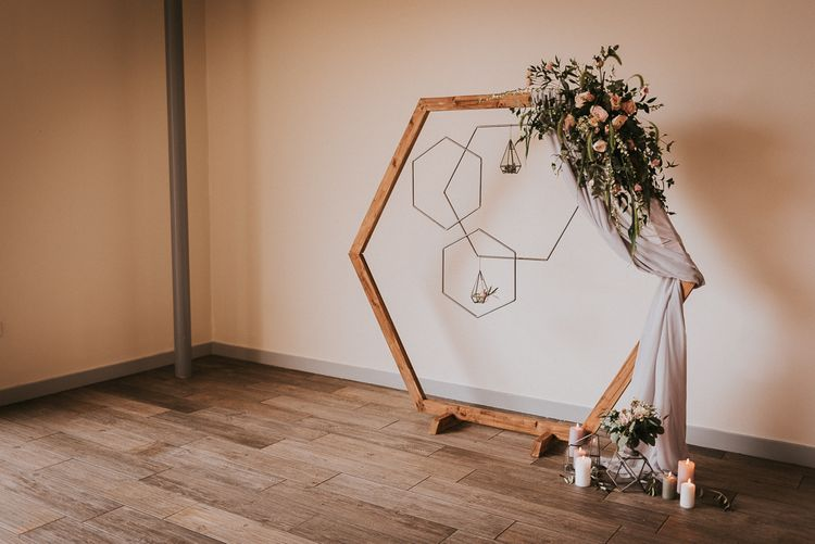 Wooden Hexagonal Arch with Hanging Geometric Hoops and Romantic Blush Pink and Greenery Flowers
