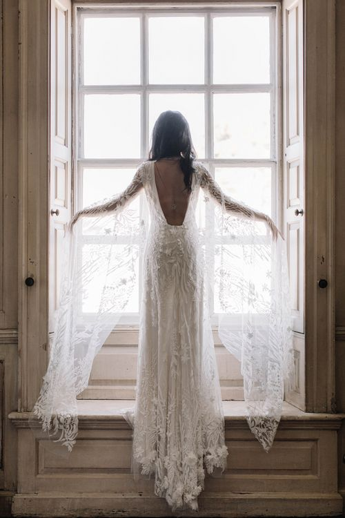 Stunning Low Back Bridal Gown with Lace and Embellishment Detail
