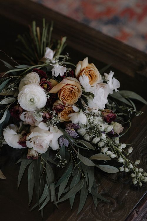 Beautiful Wedding Bouquet with White Ranunculus Flowers  and Soft Muted  Peach Roses and Foliage