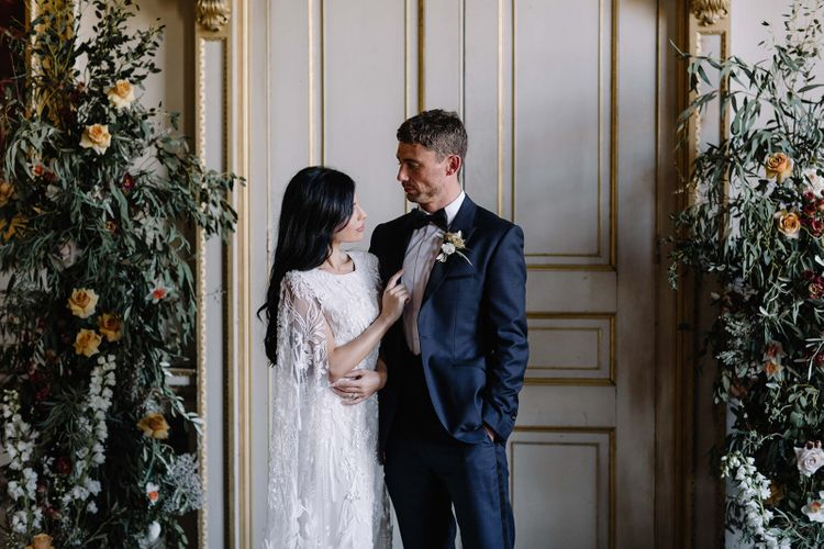 Stylish Bride and Groom at the Floral Altar in St Giles House