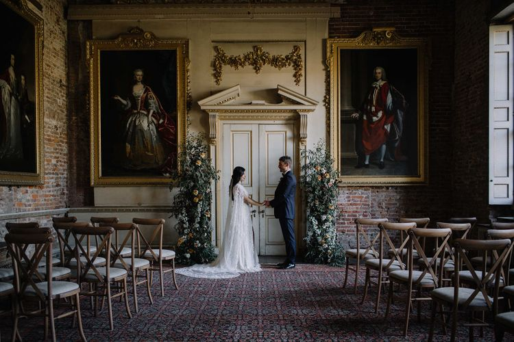 Period Ceremony Setup at St Giles House with Floral Altar