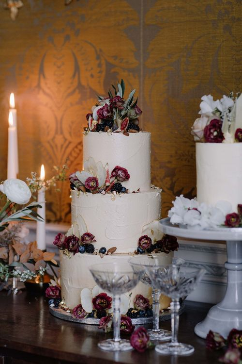 Three Tier Frosting Wedding Cake with Red Flower Decor
