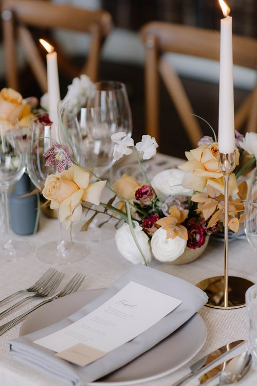 Elegant Place Setting with Grey Linen Napkin and Menu Card