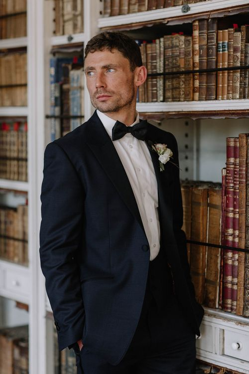 Groom in Black Marc Wallace Tuxedo with Bow Tie