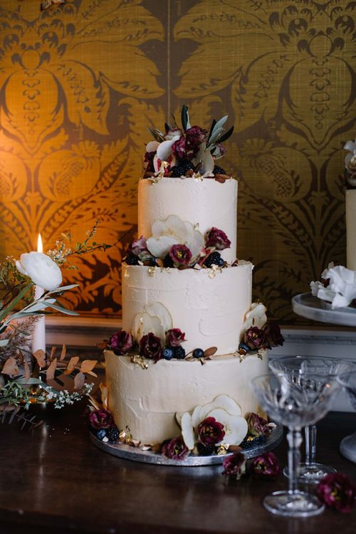 Three Tier Frosting Wedding Cake with Red Flower Decor  and Cake Topper