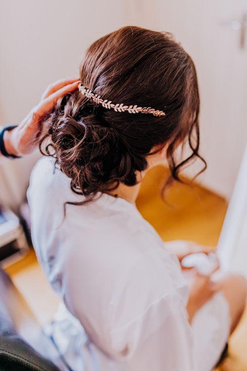 Rose gold hair vine in bridal pinned updo