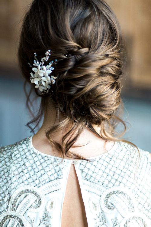 Romantic, loose, side parted updo