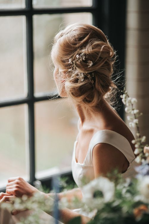 Loosely pinned wedding updo