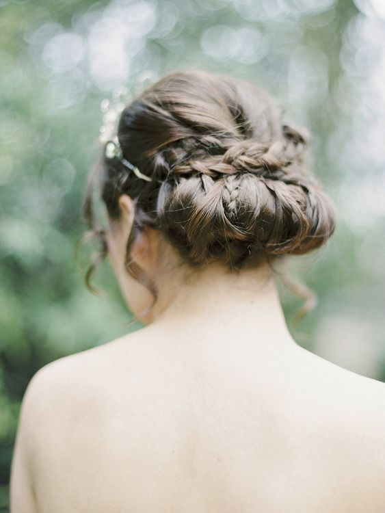 Soft roll and tuck hair design with delicate plaits