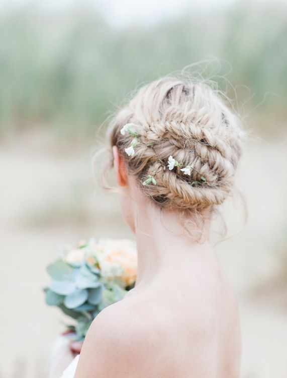 Fishtail braids with tiny petals