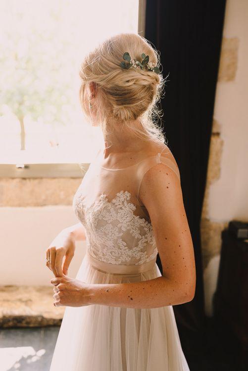 Eucalyptus in a pinned wedding updo