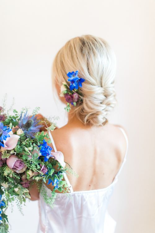 Bride with delphiniums in updo hairstyle