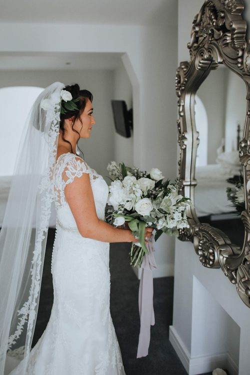 Updo with veil at crown