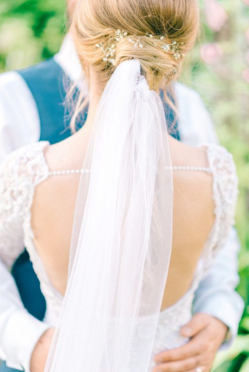 Small beehive, loose waves with veil pinned into bun