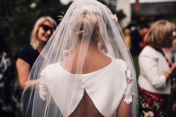 Veil pinned at crown above updo