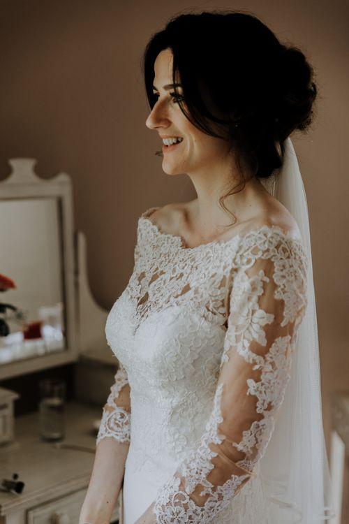 Veil pinned under loose bridal updo