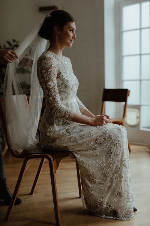 Veil pinned at crown of bridal updo