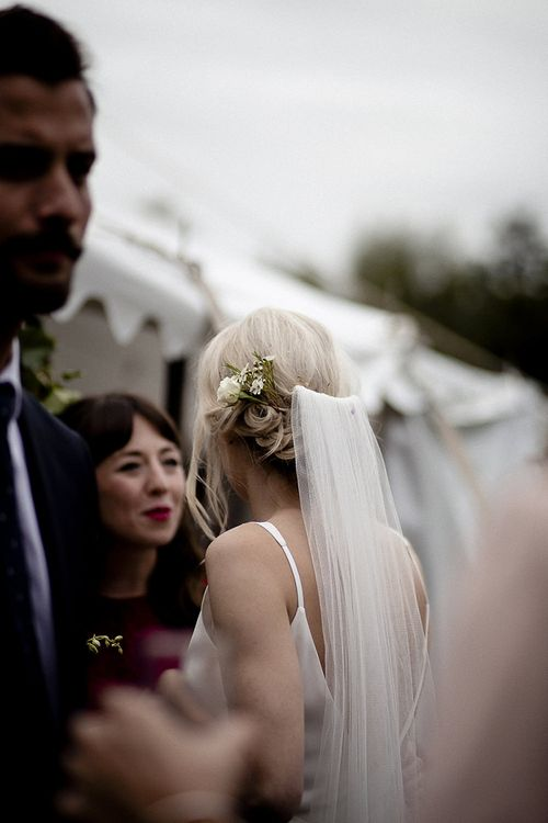 Veil pinned over loose updo