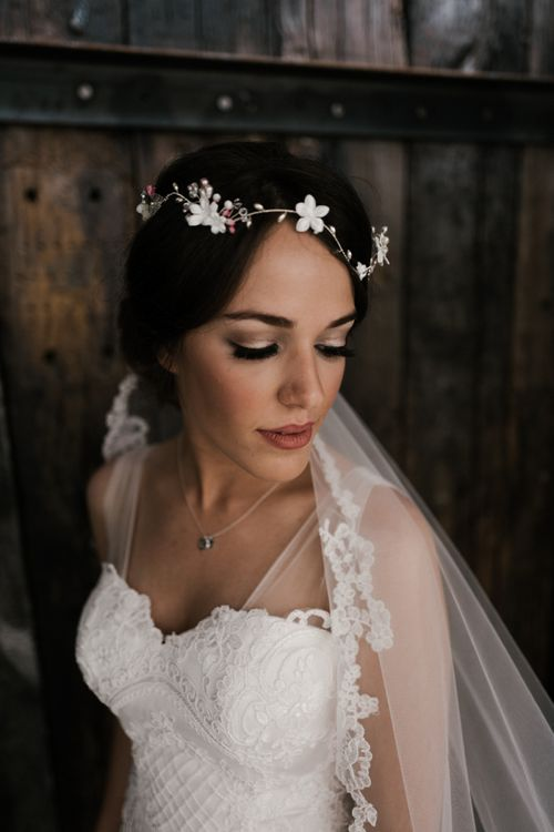 Veil pinned over loose bridal updo