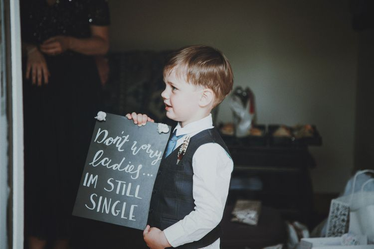 Page Boy with Chalkboard Sign   Rustic Wedding at Farbridge West Sussex with Styling by Fairly Vintage   Meghan Lorna Photography
