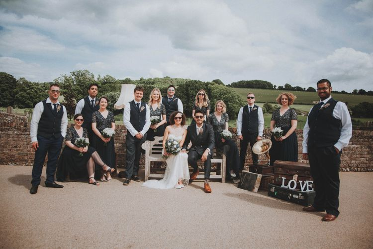 Wedding Party   Bridesmaids in Navy Dresses   Bride in Sottero & Midgley Wedding Dress   Groom in Tailor Made Suit   Rustic Wedding at Farbridge West Sussex with Styling by Fairly Vintage   Meghan Lorna Photography
