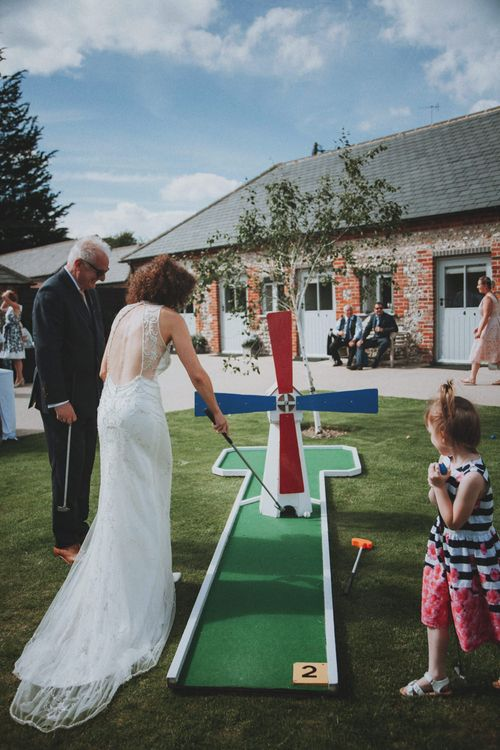 Crazy Golf Garden Game   Rustic Wedding at Farbridge West Sussex with Styling by Fairly Vintage   Meghan Lorna Photography