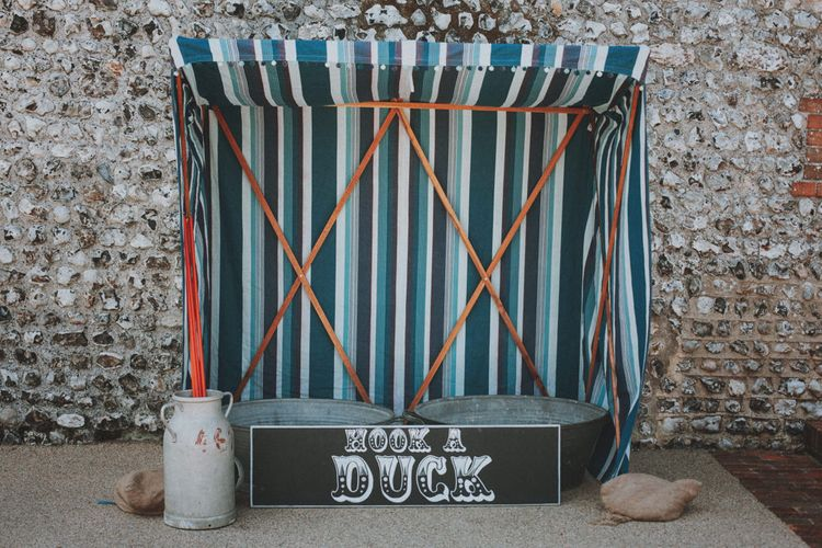 Hook a Duck Garden Game   Rustic Wedding at Farbridge West Sussex with Styling by Fairly Vintage   Meghan Lorna Photography