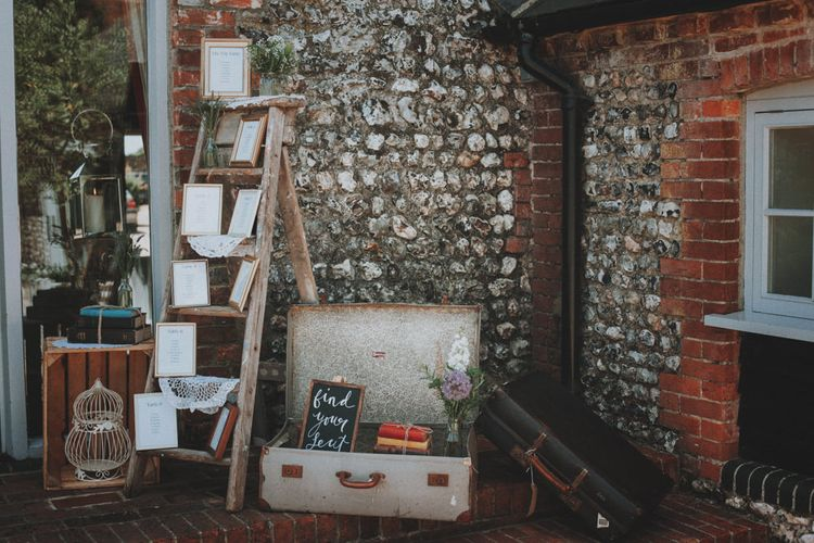 Vintage Step Ladder and Suit Case Wedding Decor   Rustic Wedding at Farbridge West Sussex with Styling by Fairly Vintage   Meghan Lorna Photography