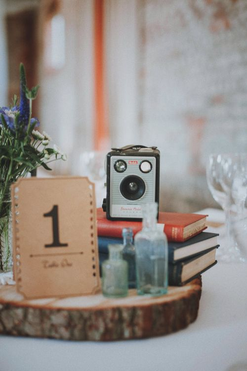 Vintage Books & Camera Table Centrepiece   Rustic Wedding at Farbridge West Sussex with Styling by Fairly Vintage   Meghan Lorna Photography