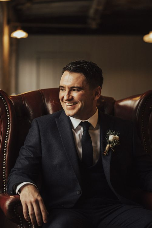 Happy Groom in Next Suit Sitting on Leather Chair