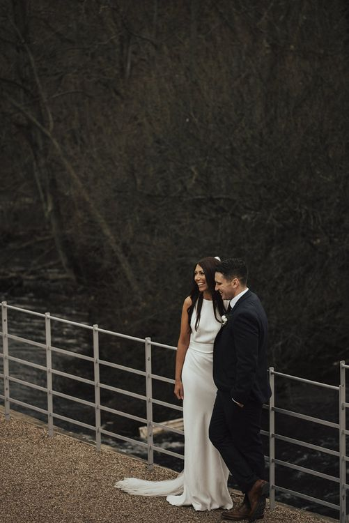 Bride in Fitted Charlie Brear Wedding Dress and Groom in  Next Suit