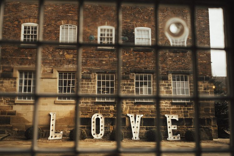 Giant LOVE Letters Outside Industrial Wedding Venue The West Mill