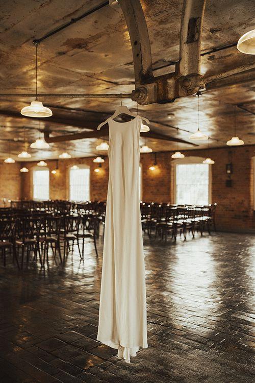 Hanging Charlie Brear Wedding Dress in Industrial Wedding Venue The West Mill